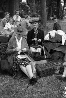 [Mrs. E. Matthews & Mrs. E. Bailey knitting for war effort at Housewives' League Picnic]