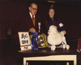 Best in Group [Toy Group: Toy Poodle] award being presented at 1974 P.N.E. All-Breed Dog Show