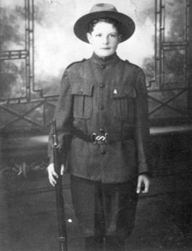 [George Thompson, Jr.in his Scout uniform]