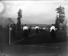[Women playing field hockey at Brockton Point grounds]