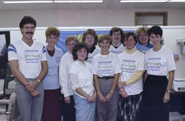 Group portrait of Centennial staff wearing Centennial t-shirts