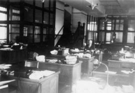 Office interior with one man at desk