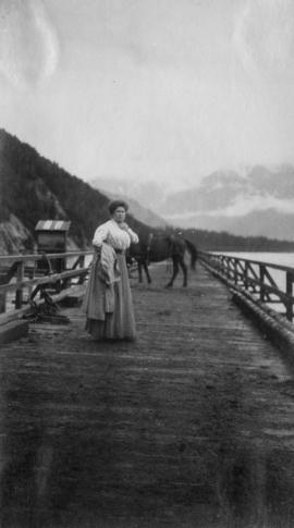 Mrs. Flora Johnson standing on a pier