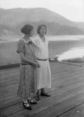 Two women on a dock