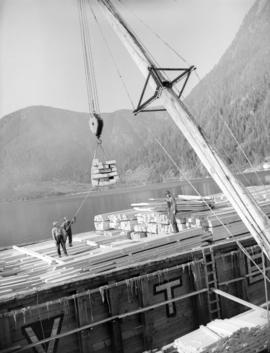 Sitka Spruce [lumber being loaded onto a barge at] Pacific Mills