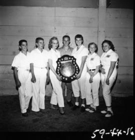 Children holding trophy from 1959 P.N.E. 4-H Clubs and Future Farmers of Canada Show