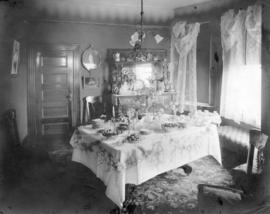 [Interior of house showing dining room prepared for afternoon tea]