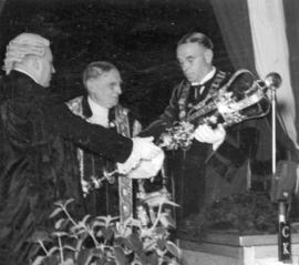 [Mayor G.G. McGeer is presented with the mace by Sir Percy Vincent in the ballroom of the old Hot...