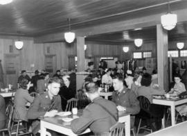 Military, police, and staff in canteen, Building D, during military use