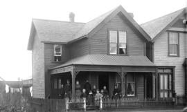 [Family assembled on porch of James Henry Tupper residence, 1232 Seymour Street]