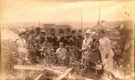 [Group assembled in garden in rear of 74 Cordova St.]