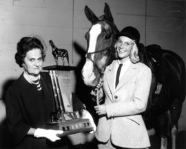"T.N. ""Nick"" Henderson trophy presented to winning rider and horse at 1964 P.N.E. Horse ..."