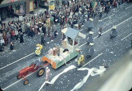 43rd Grey Cup Parade, on Granville Street, Toronto Stock Exchange float with tractor, moneybag co...