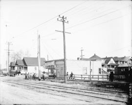 [Men erecting power pole at Commercial Drive and Eleventh Avenue]