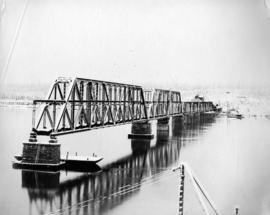 [Snow covers the partially completed bridge]