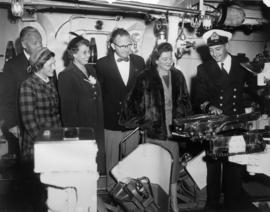 Group, including P.N.E. director H. Fairbank, and Royal Navy lieutenant commander aboard the H.M....