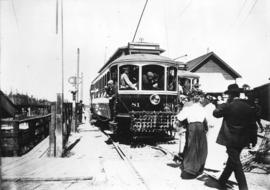 [Passengers board the Lulu Island-Eburne Interurban tram on the foot of Granville Street at False...