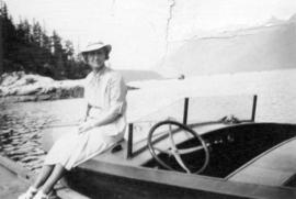 [Josephine D. Condon sitting on bow of boat]