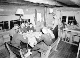 [Group of skiers playing poker in Enquist Lodge, Mt. Seymour]