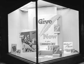 B.C. Electric Railway window display [promoting the] Community Chest