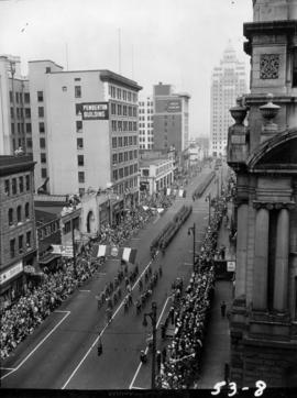 View of armed forces and bands marching in 1953 P.N.E. Opening Day Parade
