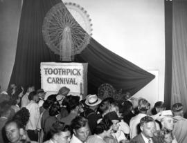 "Crowd around ""Toothpick carnival,"" models of amusement rides made with toothpicks, in P..."
