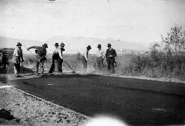 Road gang spreading asphalt, Imperial Street