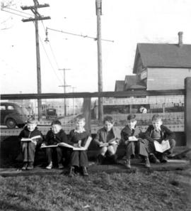 Mount Pleasant School boy pupils, sitting down outside