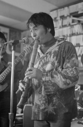 Takeo Yamashiro playing flute at Vancouver Co-op Radio