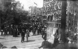 [People gathered in the street and buildings decorated for the Duke of Connaught]