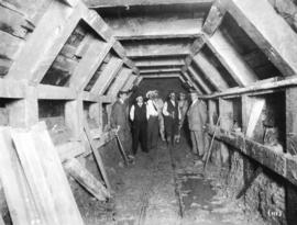 [Men in a sewer tunnel at Canoe Creek]