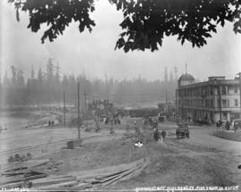 [Crowds assembled around welcoming arch assembled at Stanley Park entrance for visit of the Princ...