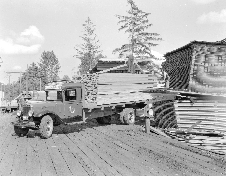 Loading lumber onto a western red cedar mills truck city for Cedar city motor company
