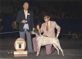Group one [Sporting Group: German Shorthaired Pointer] award being presented by judge F.N. Hall a...