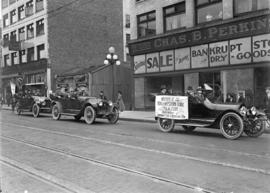 "Baseball [cars on Granville Street with banner ""Opening of the Northwestern League Season&qu..."