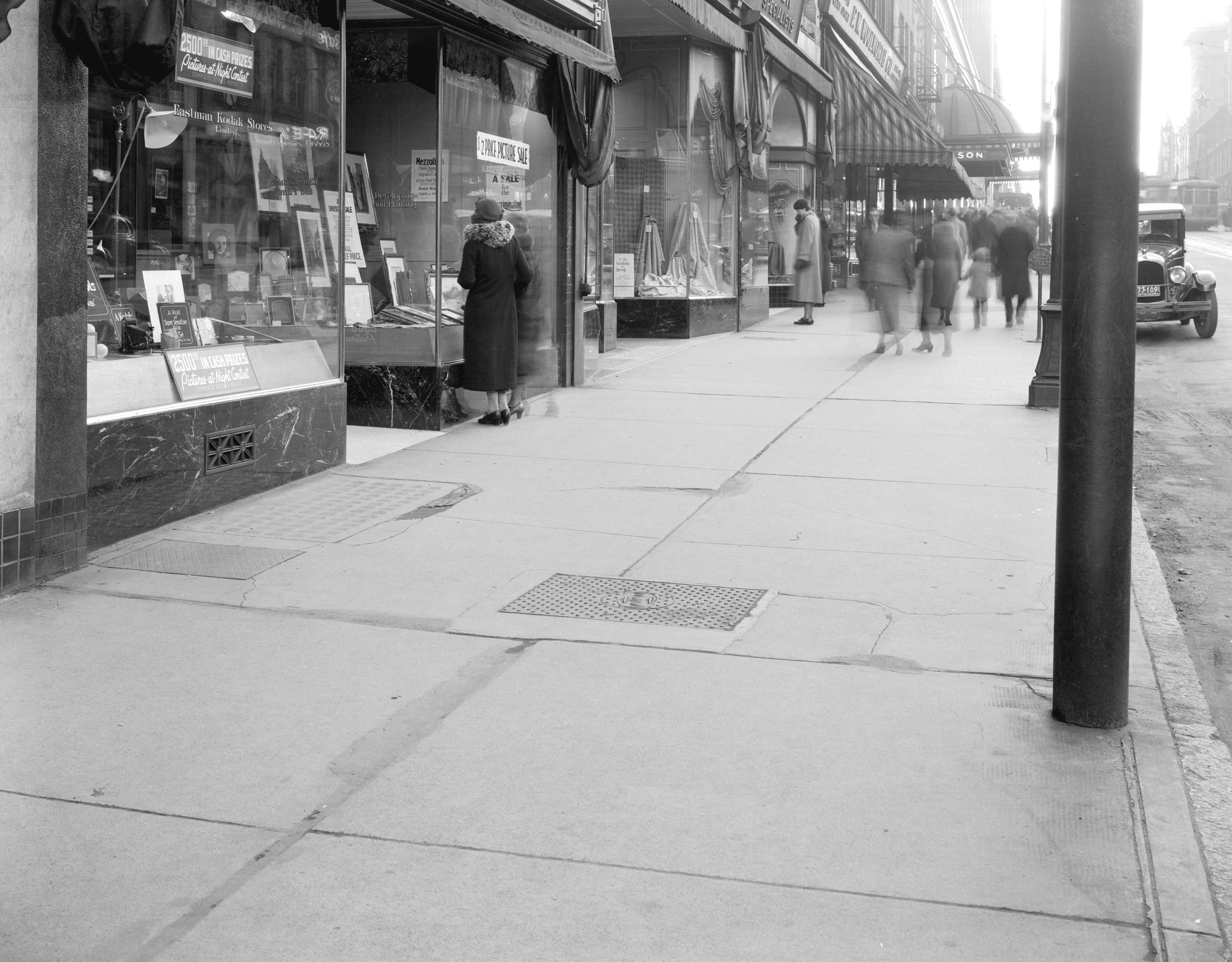 Sidewalk in front of [Eastman Kodak] store [at 610 Granville