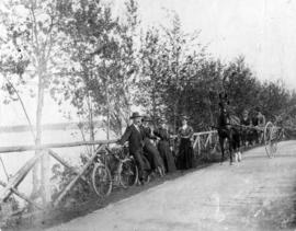 [Unidentified men and women with bicycles in Stanley Park]
