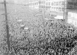 "[Crowd on Beatty Street observing Harry Gardiner (the ""Human Fly"") scale the World Tower]"