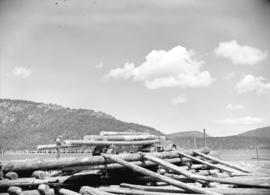 Logging truck dumping logs, Vancouver Island