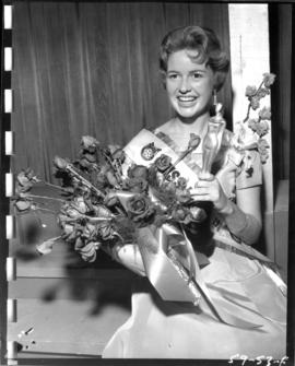 Anna Finlayson, winner of Miss P.N.E. 1959, poses with flowers and trophy
