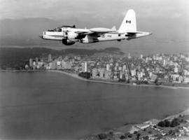 [R.C.A.F. Maritime Air Command plane No. 102 flying over English Bay]