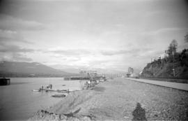 [View along the south shore of Burrard Inlet towards the Alberta Wheat Pool dock and elevator]