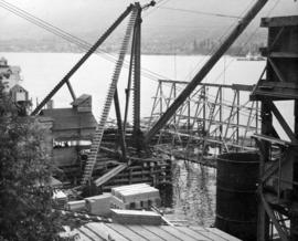 Close-up of South Shore construction plant and trestle erected in connection with underwater foun...