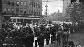 Labour Day [parade passing the Bank of Vancouver at Hastings and Cambie Streets]