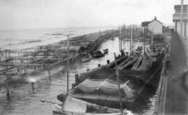 "[Net drying racks and ""Columbia River"" style fishing boats]"