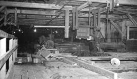 [Interior view of a ship building plant or other type of manufacturing plant]