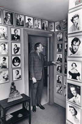 Hugh Pickett inside room decorated with framed headshots