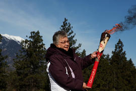 Woman holding torch in Lytton, BC [3 of 3]