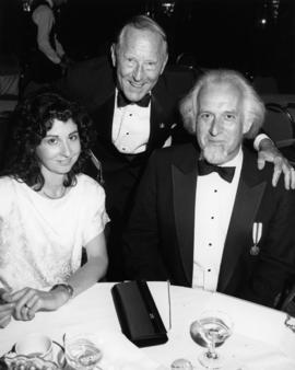Unidentified woman, Hugh Pickett and Max Wyman