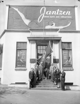 Jantzen plant salesmen and bond flag [on the front steps]